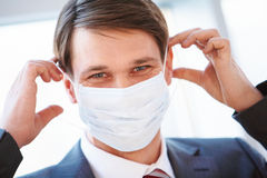 Putting on mask Royalty Free Stock Photo