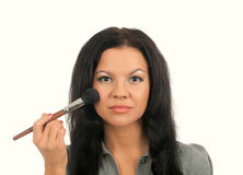 Putting on models eye make up Stock Images