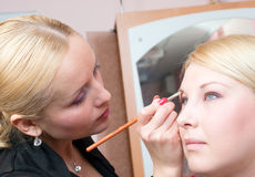 Putting on models eye make up Royalty Free Stock Photo
