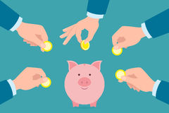 Putting money in piggy bank. Putting golden coins in piggy bank. Investment, payment, savings earnings. Pink piggy bank Royalty Free Stock Photo