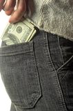 Putting money into the pocket. Isolated over white Royalty Free Stock Photo