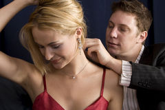 Putting on necklace Royalty Free Stock Photo