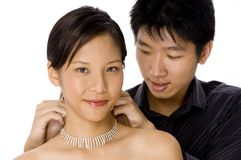 Putting on necklace Royalty Free Stock Image