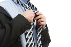 Putting on necktie. Putting on the necktie, isolated Royalty Free Stock Photography