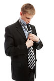 Putting on necktie Stock Photo