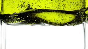 Putting olive oil in clear water stock video footage