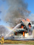 Putting It Out. This was a controled house fire in Snyder, NE.  I was there to capture a few shots just in the knick of time.  The sun was hsining just right for Royalty Free Stock Photography