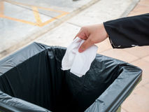 Putting paper into trash bin Royalty Free Stock Images