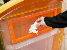 Putting paper into trash bin Royalty Free Stock Photos