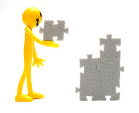 Putting pieces together. Putting pieces of puzzles together. Conceptual image Stock Image