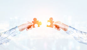 Putting puzzle pieces together Stock Photos