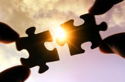 Putting puzzle pieces together Royalty Free Stock Images