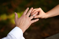 Putting ring on finger Royalty Free Stock Image