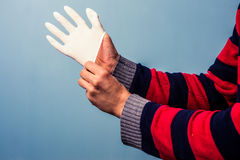 Putting on rubber glove Royalty Free Stock Photography