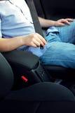 Putting on safety belt Stock Photo