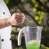 Putting Salt for making green apple smoothie Royalty Free Stock Photography