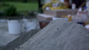 Putting sand on another pile stock video footage