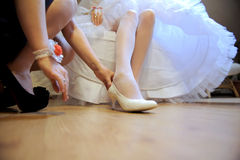 Putting on Shoe Stock Images