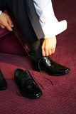 Putting on a Shoe. Businessman putting on his smart shoes to go to work Stock Images