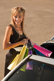 Putting shopping bags in car Stock Images