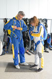 Putting on skydiving equipment Stock Image