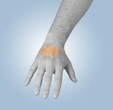 Putting a small adhesive, bandage on an arm Royalty Free Stock Image