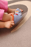 Putting On Socks. An independent child puts on her own socks like a big girl Royalty Free Stock Image