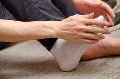 Putting socks Stock Images