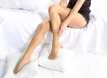 Putting stockings on sexy legs Royalty Free Stock Photo