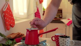 PUTTING SUGAR IN COFFEE POT. GAS BURNER IS ON, WATER BOILING stock video