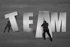 Putting TEAM concrete word together Royalty Free Stock Images