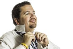 Putting on a Tie Stock Images