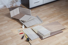 Putting Together Self Assembly Furniture chipboard parts lie on Stock Photo