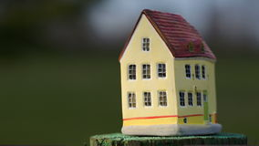 Putting a toy house on small stub stock footage