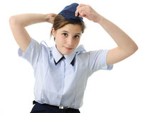 Putting on the Uniform Hat Stock Photo