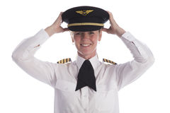 Putting a uniform hat on head Royalty Free Stock Images