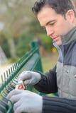 Putting up garden fence Stock Photos
