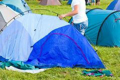 Putting up tent in a camping Stock Image