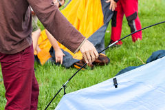 Putting up tent in a camping Royalty Free Stock Photos