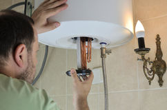 Putting a water heater stock image