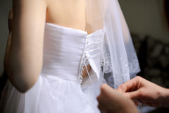 Putting on Wedding Dress Royalty Free Stock Image