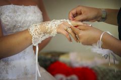 Putting wedding gloves on. With the help of bridesmaid Stock Photography