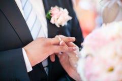 Putting the wedding ring Stock Photo