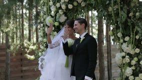 Putting wedding ring stock video footage