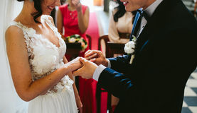 Putting the wedding ring on Stock Photos