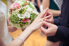 Putting the wedding ring Royalty Free Stock Photo
