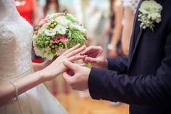 Putting the wedding ring Royalty Free Stock Photography