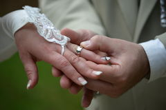 Putting on the wedding ring Stock Photography