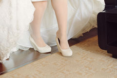 Putting on Wedding Shoes Stock Photography