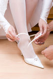 Putting on a white shoe Royalty Free Stock Image